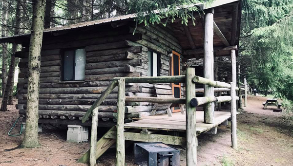 A log cabin for camping.